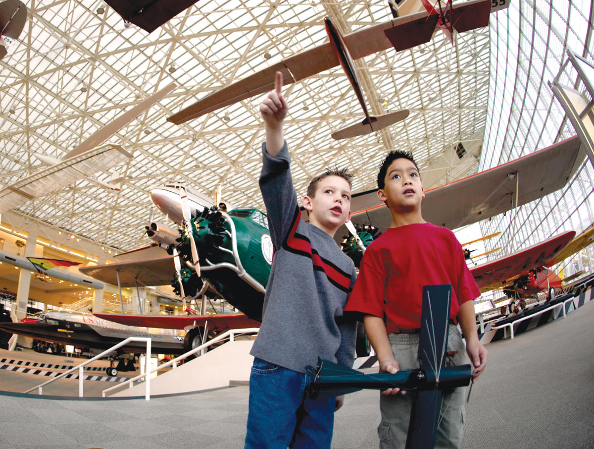 Young Boys Looking up at Planes in the Museum of Flight