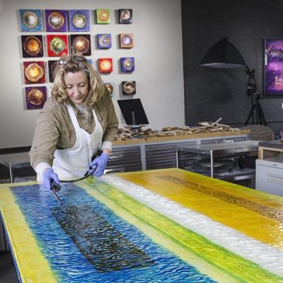 Constance Williams, encaustic artist, at work in her studio