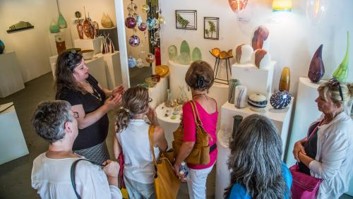 Women Peruse a Glass Art Gallery on a Guided Art Connections Tour