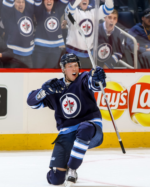 #29 Patrik Laine celebrates after scoring a goal in front of the home crowd at Bell MTS PLace.