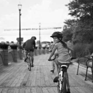 Lansing-River-Trail-girl-on-bike-199x300