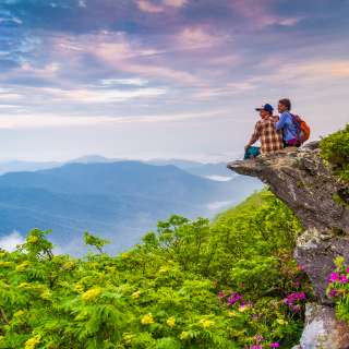 Hiker Couple at Craggy Pinnacle at Sunrise