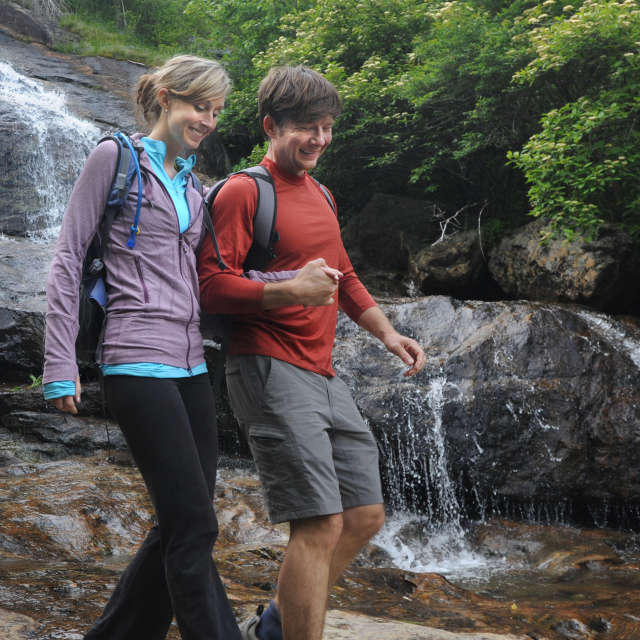 Couple hiking at waterfall