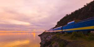 Alaska Railroad train on Turnagain Arm at sunset
