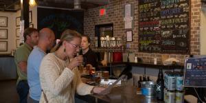 People tasting beer at Old Ox Brewery