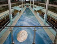 Photo of artwork Forces of Nature, deep green and blue terrazzo floor installation.