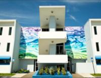 Photo of multi-colored mural painted on the two-story Amman Building.