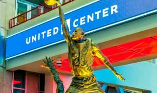 Image of famed bronze Michael Jordan Statue dunking a basketball