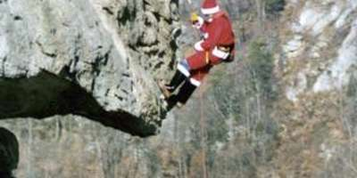Extreme Santa Will Climb Chimney Rock