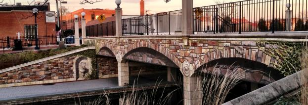 Unique tiles decorate this bridge over Carroll Creek Park.