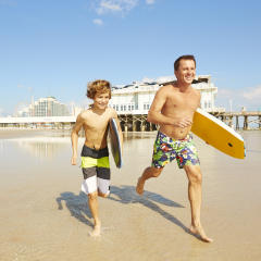 Surfing, father and son