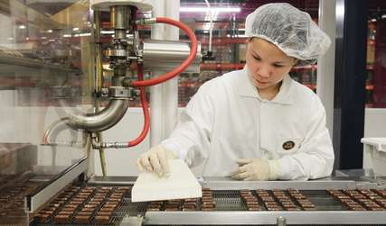 Seattle Chocolate Tour Factory Worker making chocolate