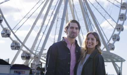Couple in Front of Seattle Great Wheel
