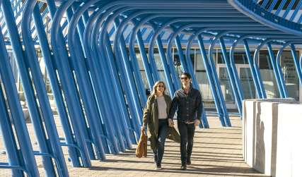 Couple Walking at Angle Lake Light Rail Station
