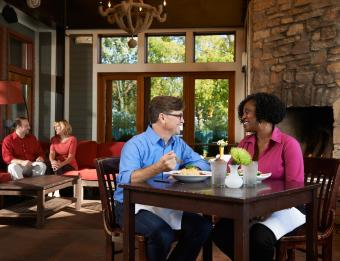 Couple dining indoors at Roses on Reeds Lake