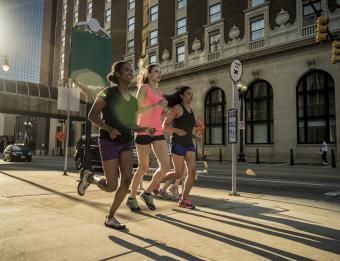 Women running in downtown Grand Rapids
