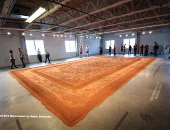 Rena Detrixhe's Red Dirt Monument was the time-based public vote and juried vote winner for ArtPrize Nine.