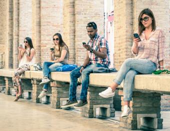 millennials staring at smartphones