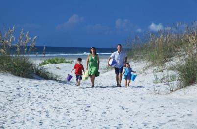 Family walking through dunes