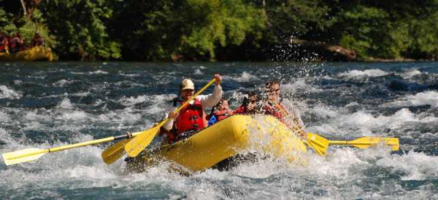 Shooting the McKenzie River rapids with TnT Whitewater Rafting