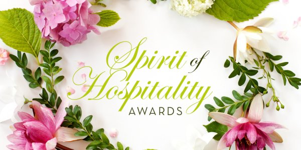 2018 Spirit of Hospitality Awards Banner with floral arrangement
