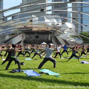 Participants doing yoga in Millennium Park