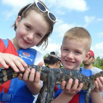 Family Fun - Cajun Encounters - kids with alligator