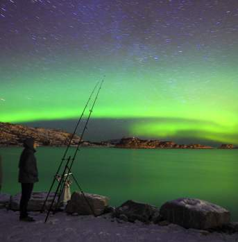 Fishing under the Northern Lights in Bessaker