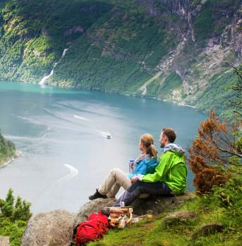 Couple enjoying the view by the Geiranger fjord