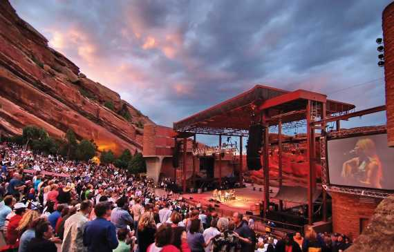 Concert goers enjoy an evening of entertainment at Red Rocks Park & Amphitheater.