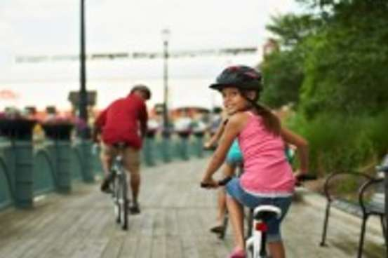 Lansing-River-Trail-girl-on-bike-199x300