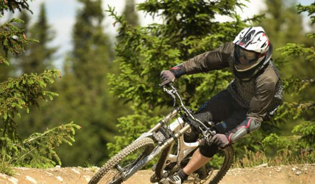 A person on a downhill mountain bike in Hafjell Bike Park