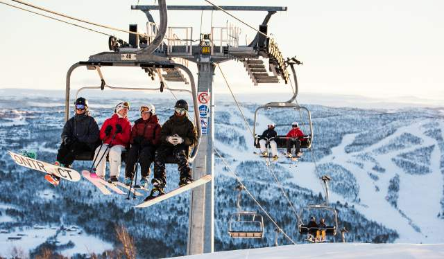 Skiers in the chairlift in Geilo