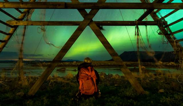 Person viewing the northern lights over Tromsø