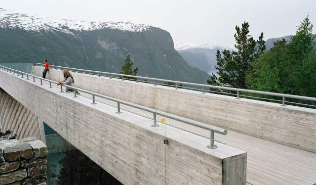 Two people standing apart at Stegastein Viewpoint