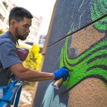 Illuminaries paint a mural at Oakland Marriott