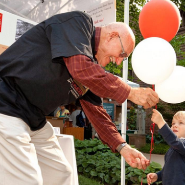 Child receiving balloons at Frank Lloyd Wright event