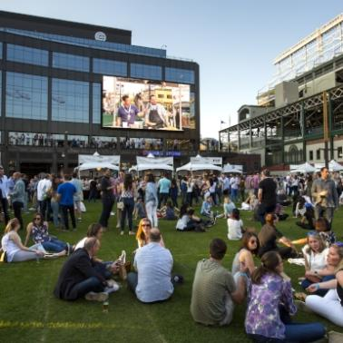 View of the greenspace and tv screen next to Wrigley Field.