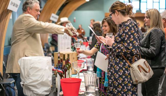 Vendor Pouring a Glass of Wine at an Event