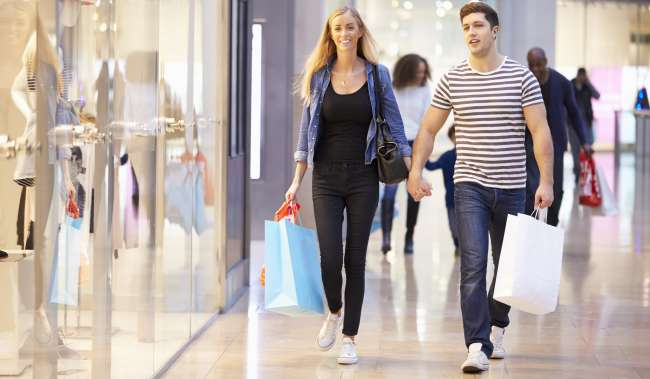 Man and Women shopping in a mall