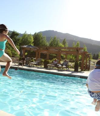Children Jumping into the Pool at Hotel Park City