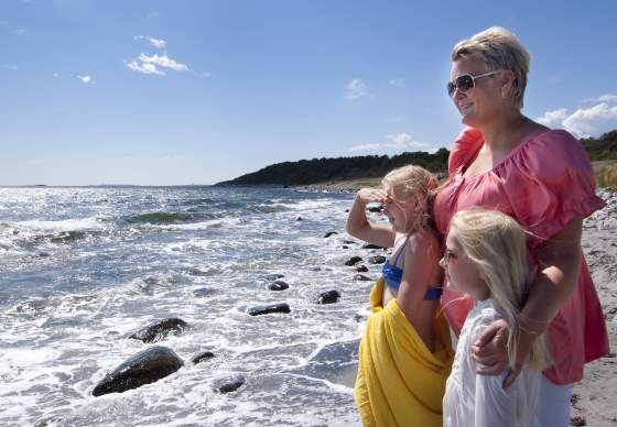 Woman and children overlooking the sea