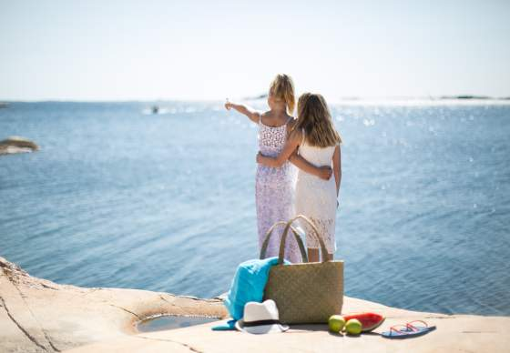 Girls overlooking sea on a summer day
