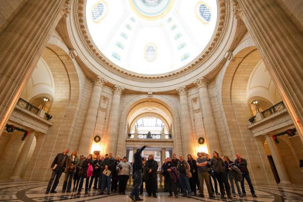 People learning about the Hermetic Code at the Manitoba Legislative Building
