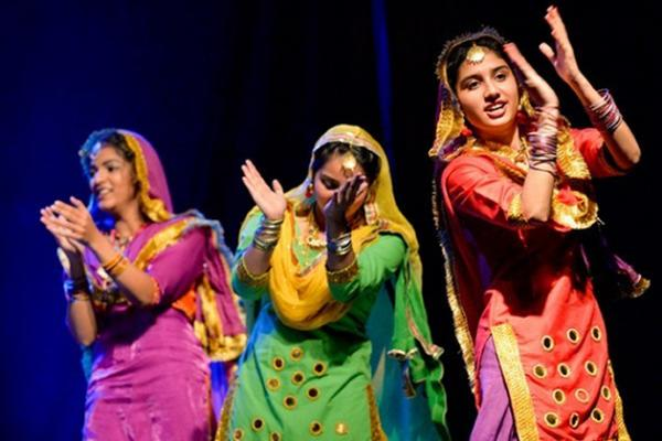 Colourfully dressed dancers at the Indian Pavilion during Folklorama