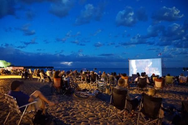 Watching movies on the beach during the Gimli Film Festival