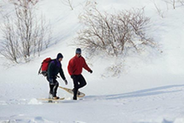 Snowshoeing in the open fields of Manitoba