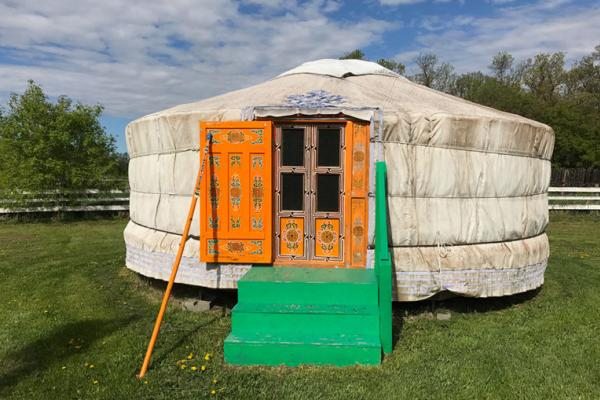 exterior shot of a traditional yurt  at the Journey Home Artist Retreat