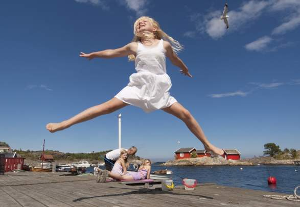 Girl jumping and having fun in Southern Norway