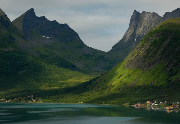 Majestic mountains rising from the sea in Senja